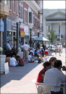 Summer in Schenectady with residents sitting outdoors